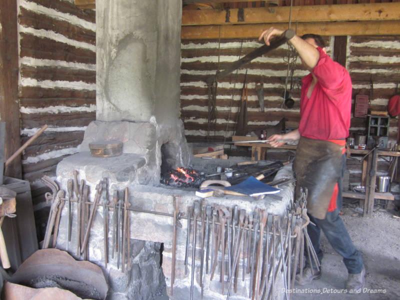 Blacksmith at work at Fort Gibraltar in Winnipeg, Manitoba