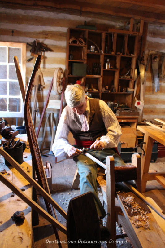 Interpreter making snowshoes at Fort Gibraltar in Winnipeg, Manitoba