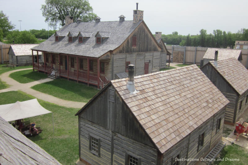 The Great Hall and other wooden structures of Fort Gibraltar in Winnipeg, Manitoba as viewed from the second level of the wall around the fort