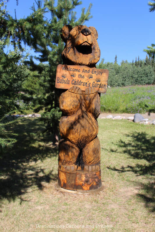 Bear carving welcoming you to the Babula Children's Garden in the Georgeson Botanical Garden in Fairbanks, Alaska