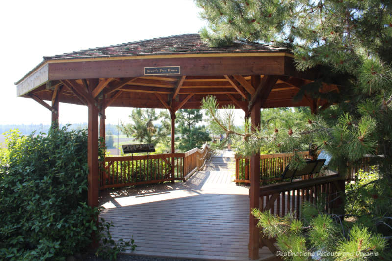 Covered gazebo and wood walkway in Georgeson Botanical Garden in Fairbanks, Alaska