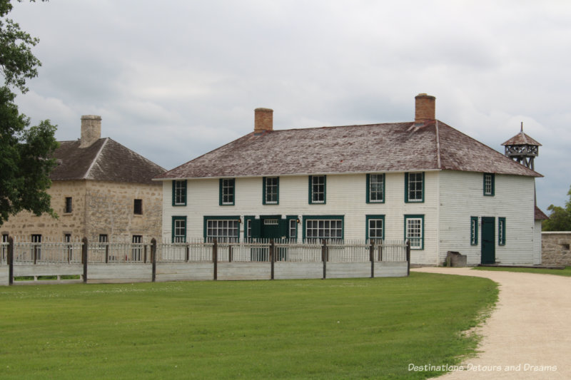 A rebuilt wood building and an original stone building at Lower Fort Garry
