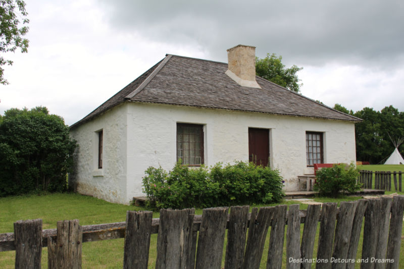 White cottage used to house guests at Lower Fort Garry
