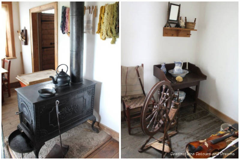 Black stove in kitchen area and spinning wheel and chair in sitting room of farm manager's house at Lower Fort Garry