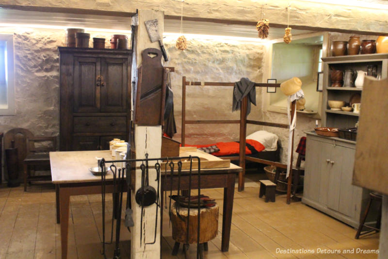 Kitchen area in the Big House at Lower Fort Garry complete with sleeping cot for staff