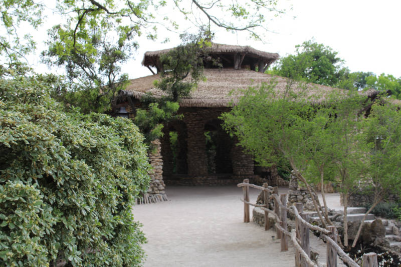 Stone pavilion with thatched roof in San Antonio Japanese Tea Garden