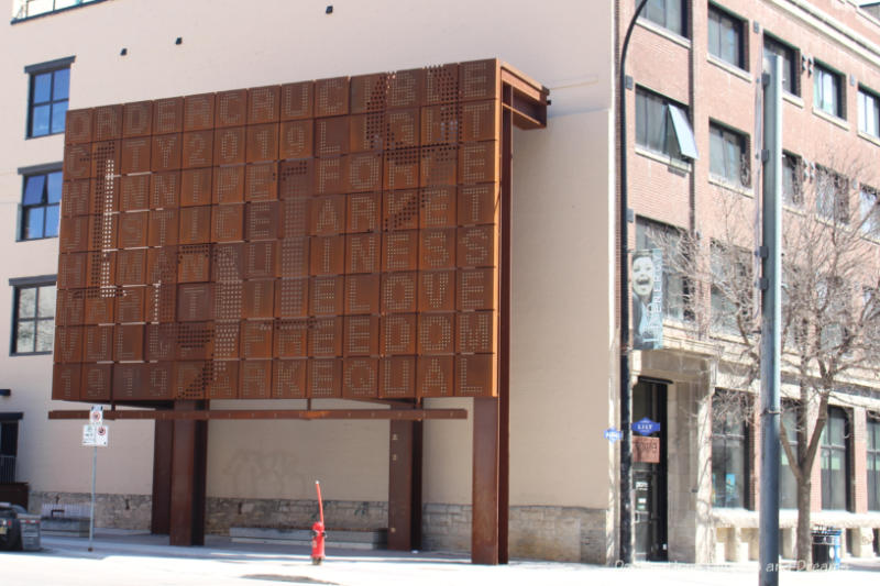 Billboard-style public art piece made of weathering steel in Winnipeg's East Exchange District commemorating the 1919 General Strike