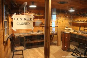 Workshop with On Strike Closed sign in window at Manitoba Museum