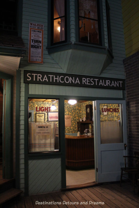 Restaurant at Manitoba Museum exhibit with a Permitted by Strike Committee sign in window