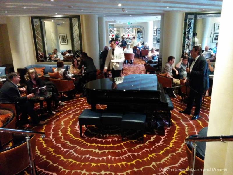 Grand piano in the centre of the room at the American Bar in London's Savoy Hotel