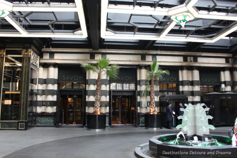 Covered outside art deco entrance area of the Savoy Hotel in London