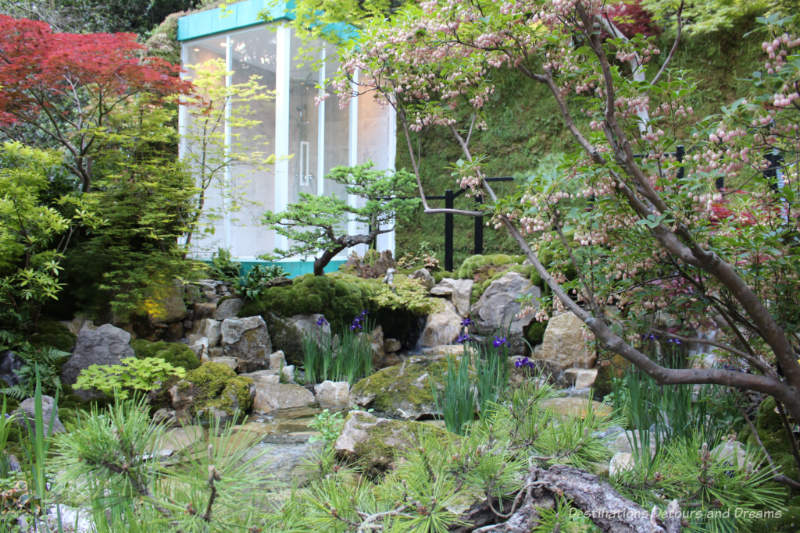 Glass shower house in a tranquil Japanese-style garden, the Green Switch Garden at the 2019 Chelsea Flower Show