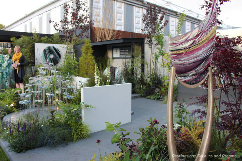 Display of glass art by Carrie Anne Funnell amid plantings at the 2019 Chelsea Flower Shower
