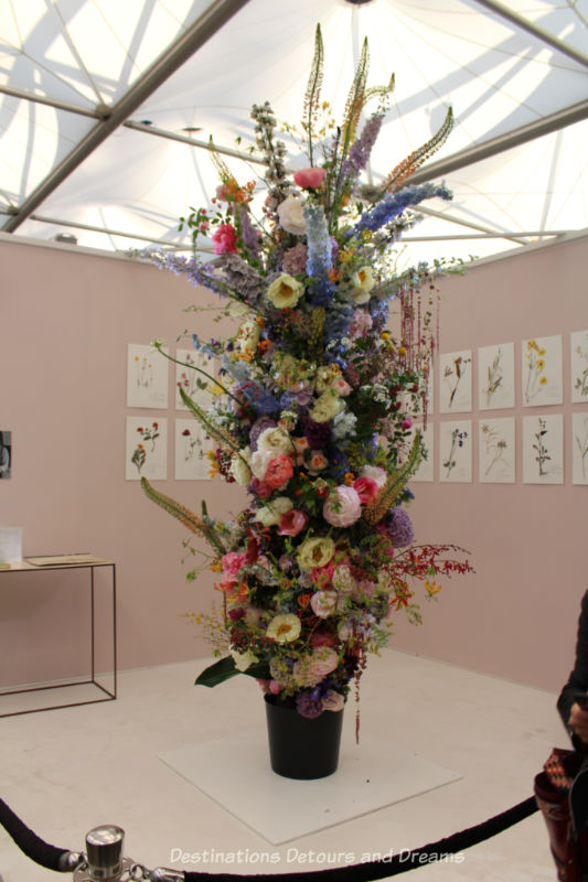Cut flowers on an upright birch pole create a 3m-tall living herbarium at the 2019 Chelsea Flower Show