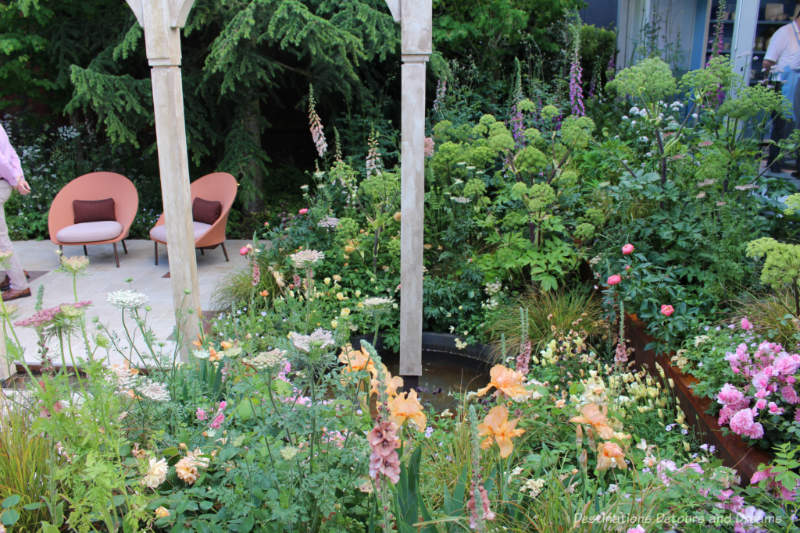 Pond, greenery and architectural structure in the Wedgwood Garden at the 2019 Chelsea Flower Show