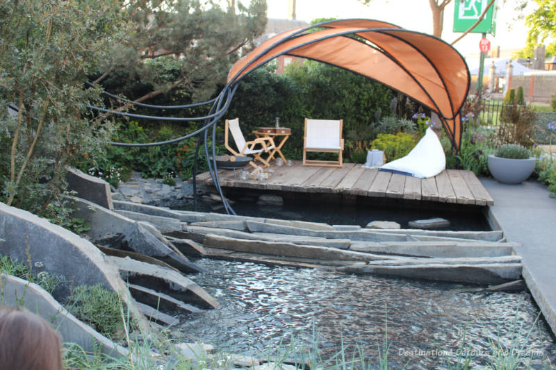 Wooden patio area over water in the Facebook Garden: Beyond the Screen at the 2019 Chelsea Flower Show