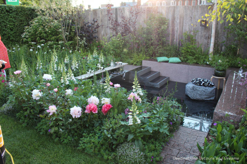 A sunken sitting space inside an urban garden - the Roots In Finland Kyrö Garden at the 2019 Chelsea Flower Show