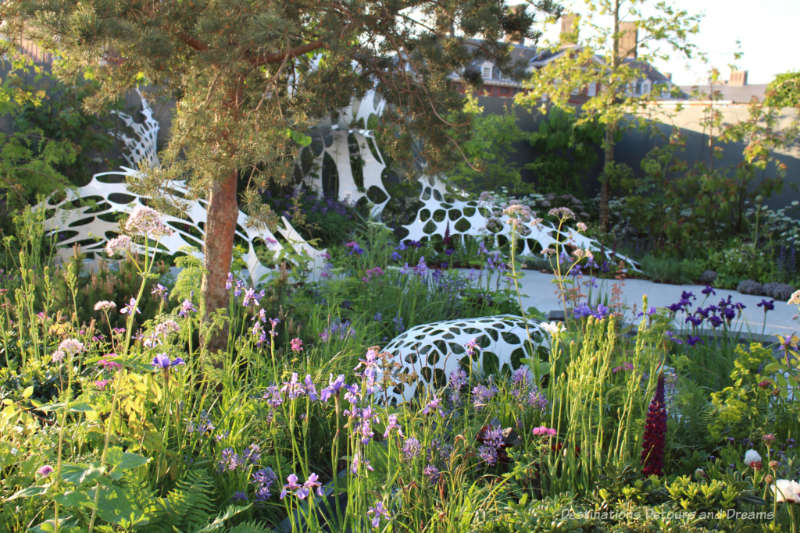 Plants flowing around an undulating white sculpture in the Manchester Garden at the 2019 Chelsea Flower Show