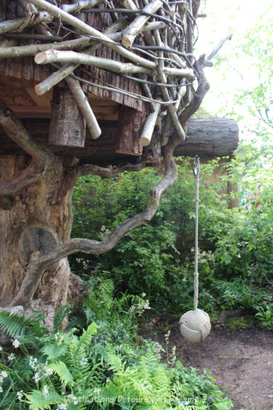 Treehouse and swing at the RHS Back to Nature Garden at the 2019 Chelse Flower Show