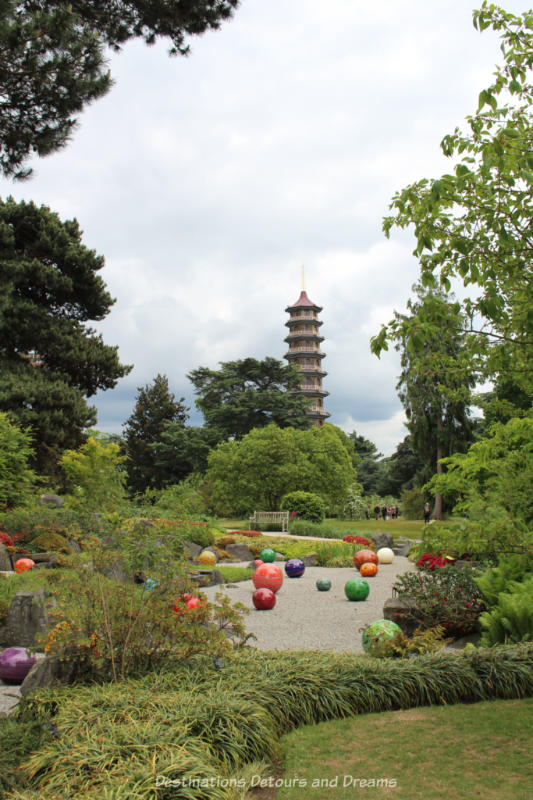 Chihuly Niijima Floats glass art at Kew Gardens with view of the Great Pagoda in the background
