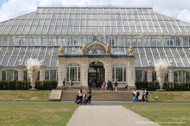 The Temperate House at Kew Gardens with identical Chihuly sculptures one either side of the enrance