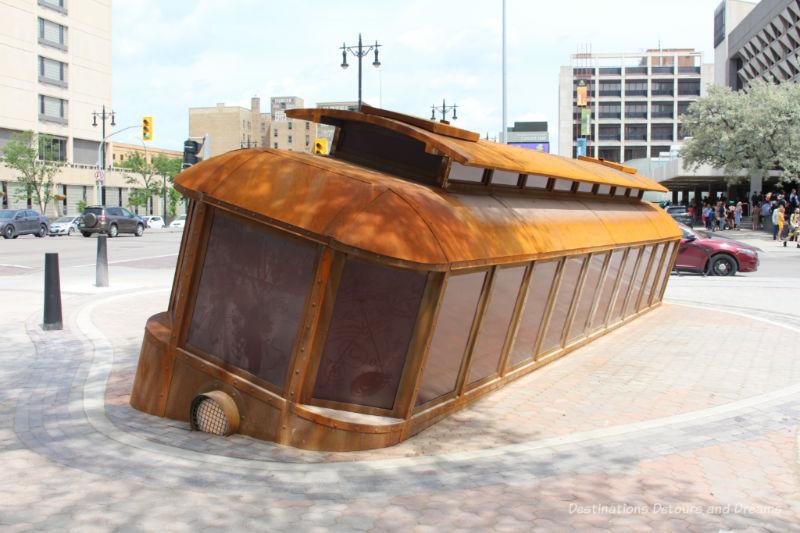 Tilted streetcar sculpture in Winnipeg, Manitoba