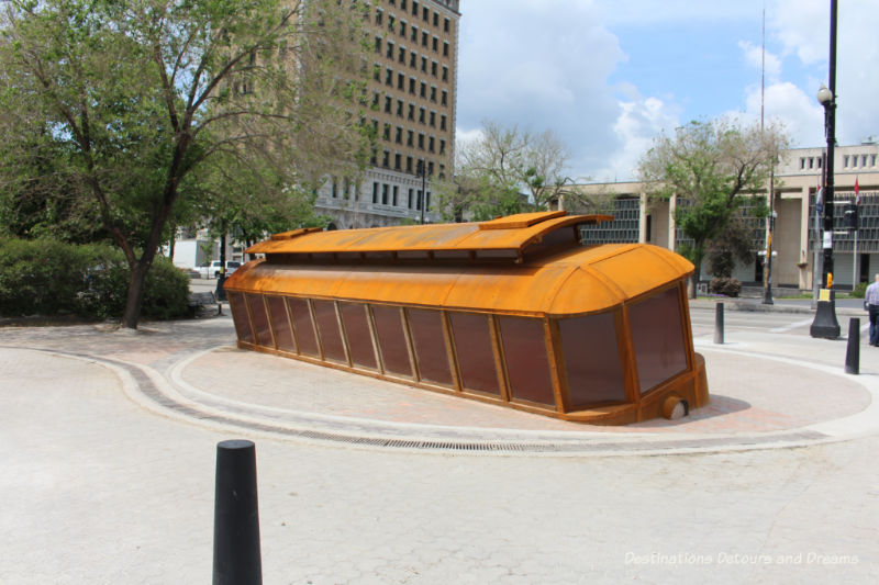 Bloody Saturday sculpture in Winnipeg, Manitoba: a tilted streetcar remembering the violent events of Bloody Saturday in the 1919 Winnipeg General Strike
