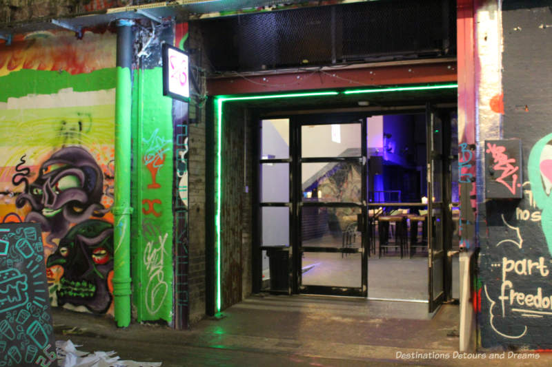Doors from London Leake Street Tunnel through an archway reveal an entertainment venue