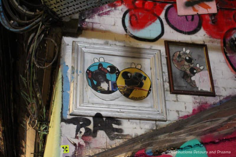 Graffiti art in a picture frame in Leake Street Tunnel