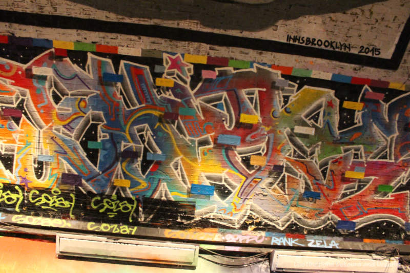 Geometric graffiti on wall of London Leake Street Tunnel