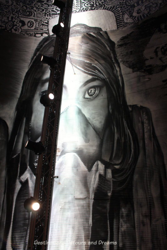 Graffiti girl painted on ceiling of London Leake Street Tunnel