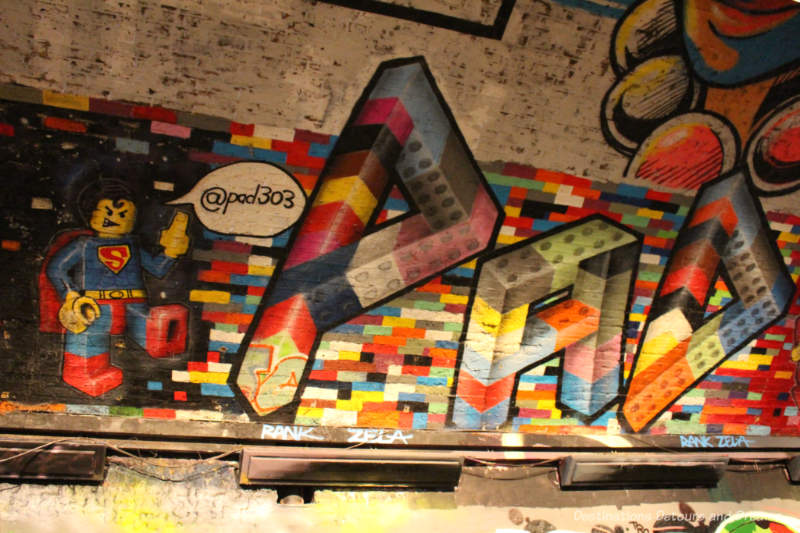 Lego Superman painted on wall of London Leake Street Tunnel