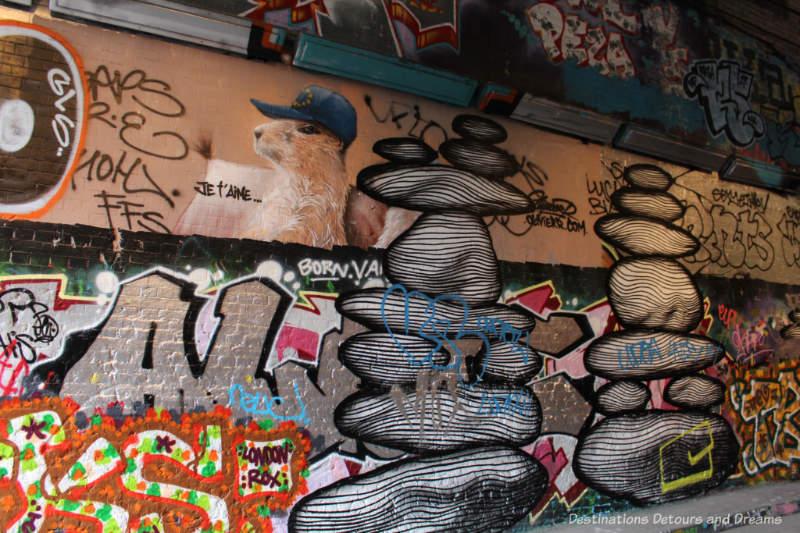 Paintings on wall of London Leake Street Tunnel