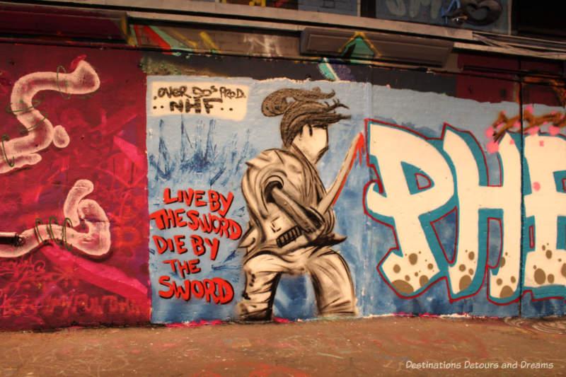 Graffiti painting in London Leake Street Tunnel