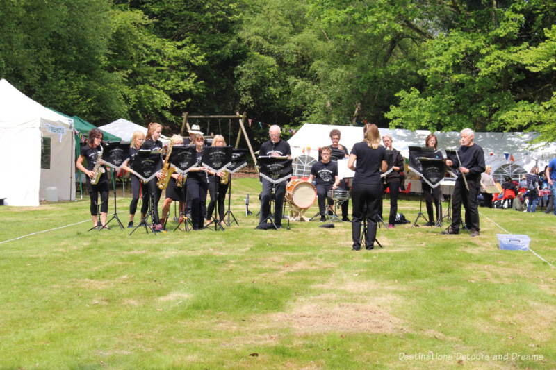 Village band playing in the centre of the square at an English village fête