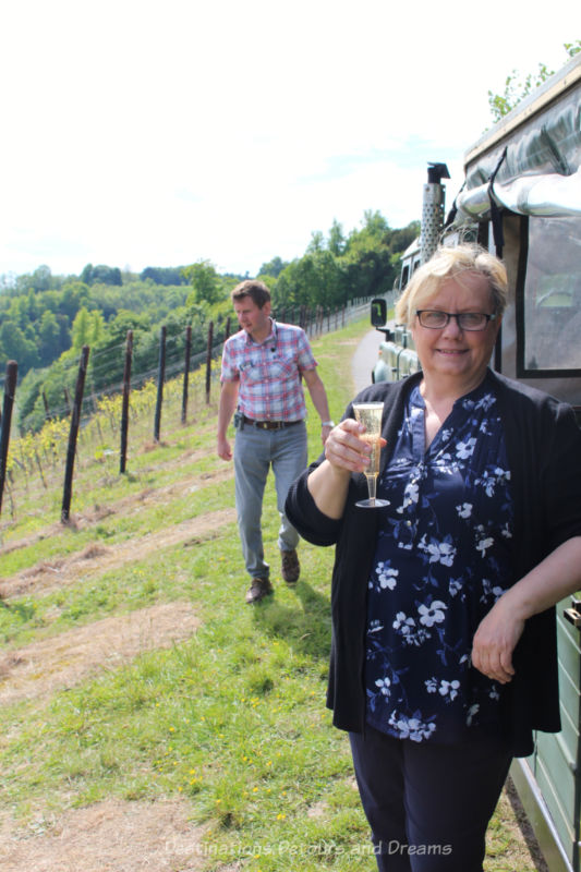 Blogger with a glass of bubbly on the Denbies Wine Estate Vineyard Tour