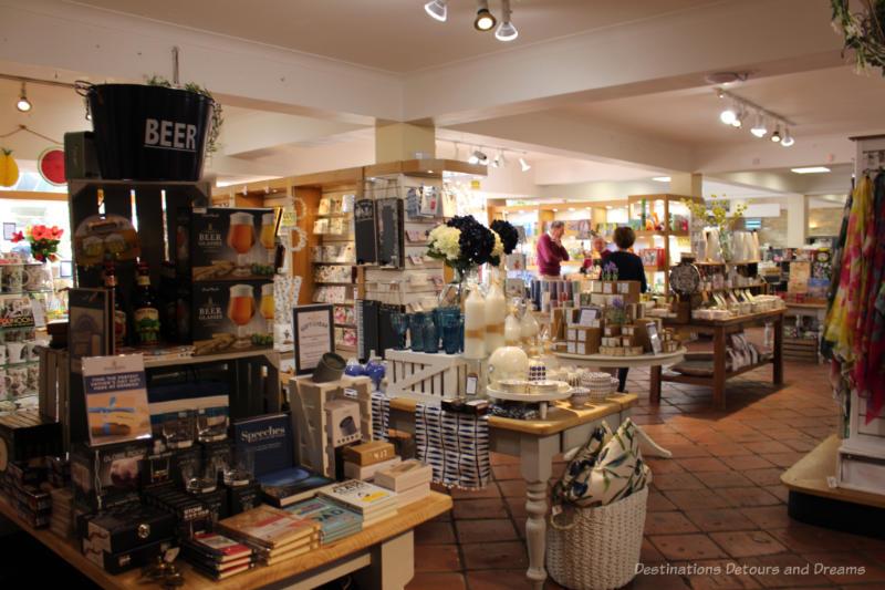 Tables and shelves of goods inside Denbies Wine Estate Gift Shop