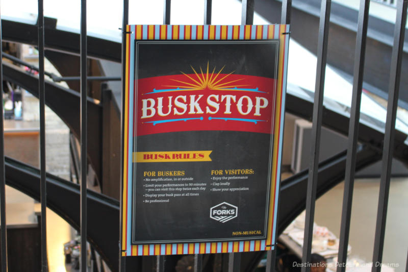 Buskstop sign indicating a place at The Forks to find street performers