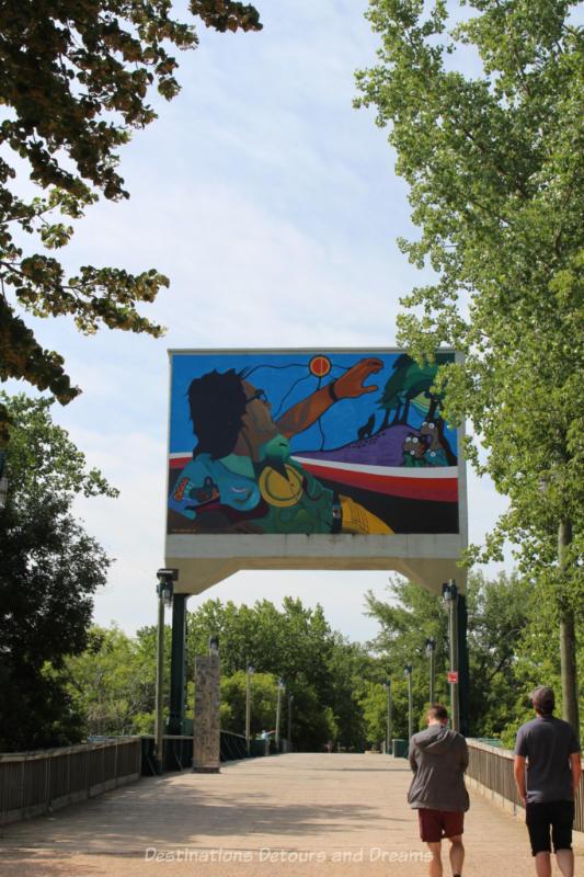 Indigenous art mural on the former rail bridge at The Forks in Winnipeg