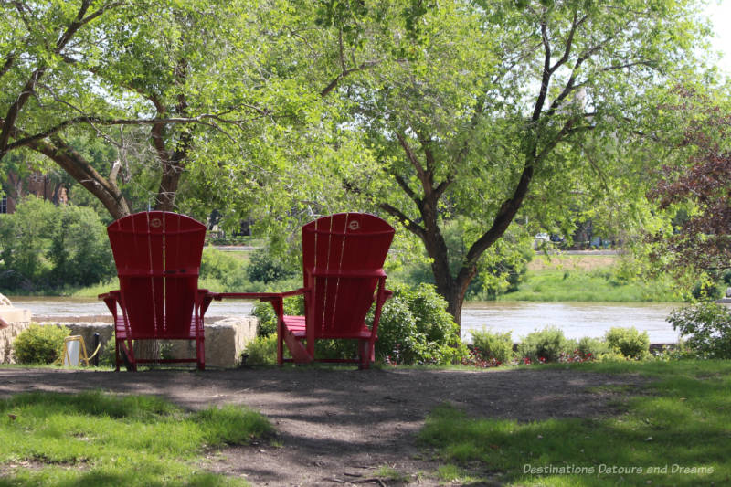 Parks Canada red chairs at The Forks