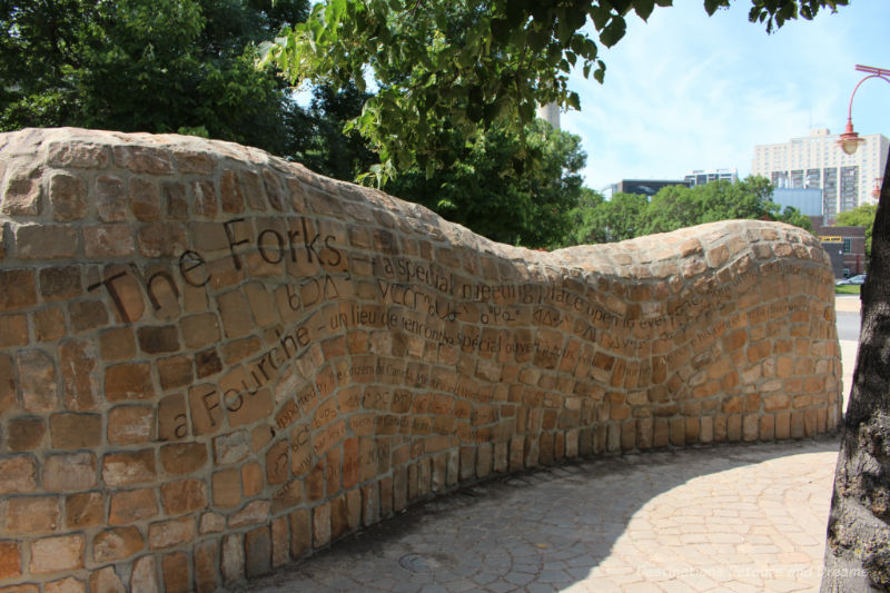 Stone wall with The Forks mission on it