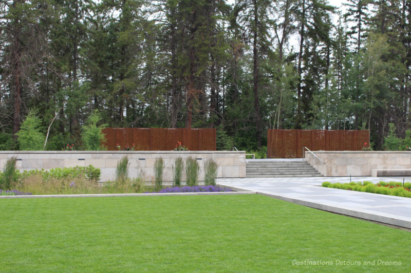 Metal fencing panels and steps leading into the Aga Khan Garden at the Jilau Khana threshold