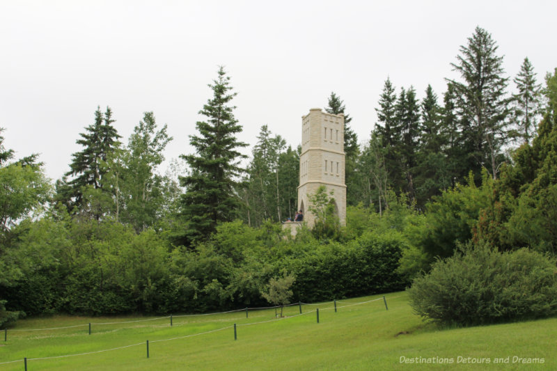 Manitoba Tyndall stone tower, John's Folly, amid trees at University of Alberta Botanic Garden