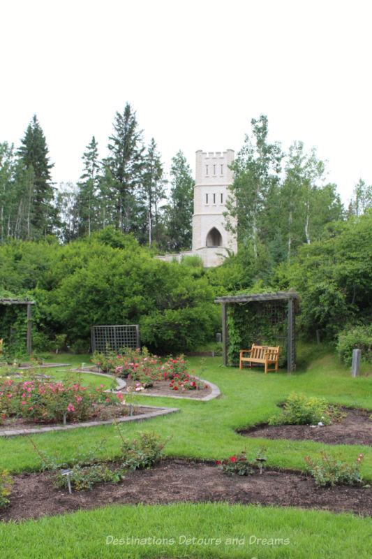Folly tower of Manitoba Tyndall stone behind the Rose Garden at University of Alberta Botanic Garden