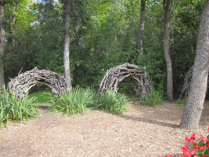 Crawl tunnels made out of bent twigs in a nature playground