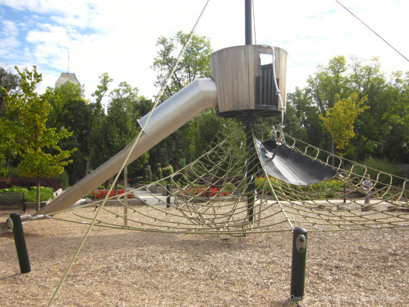 Playground structure with slides and rope climbing area at Assiniboine Park In Winnipeg