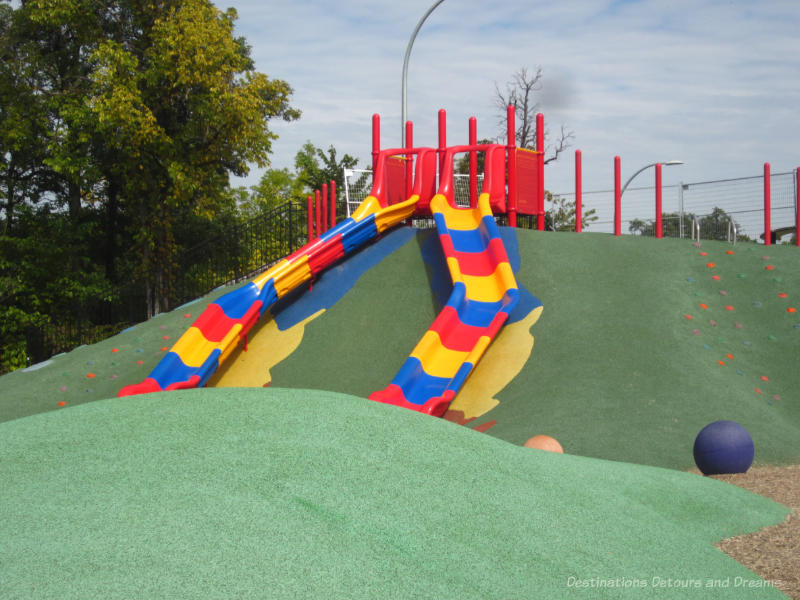 Red, yellow, and slide on a hill in a nature playground