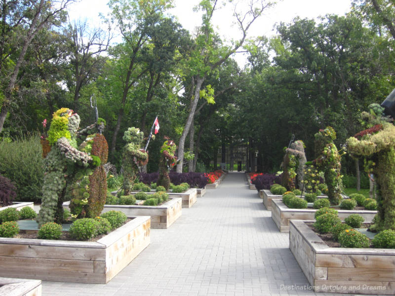 Garden walkway bordered by topiary musicians