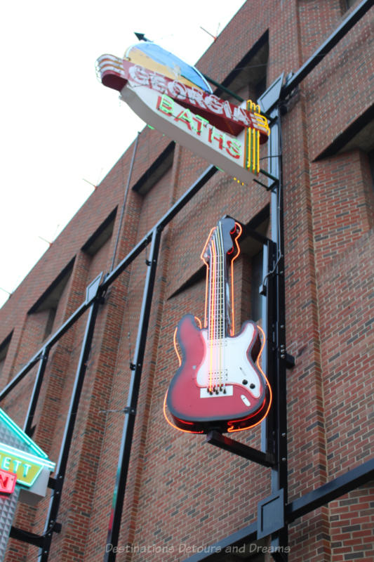 Georgia Baths and a guitar neon signs at the Edmonton Neon Museum