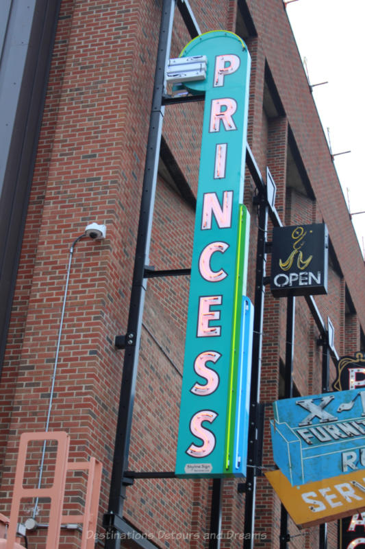 Vertical neon sign with PRINCESS written on it at the Edmonton Neon Museum